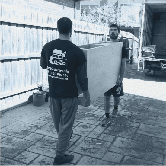 Removalists carrying an item