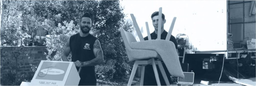 removalists holding chairs