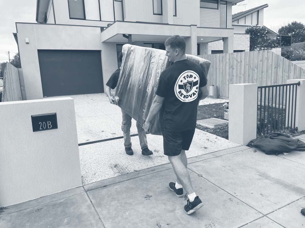 Removalists carrying a sofa